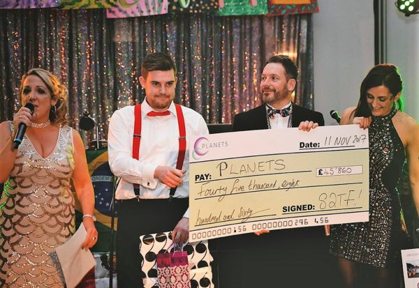 colin zaczyk collects charity ceque on behallf of Regal Homes